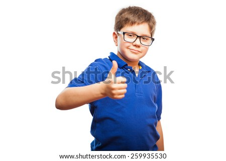 Studio portrait of a cute young boy with glasses giving you a thumb up - stock photo