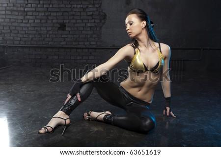 Studio portrait of a fashionable girl - stock photo