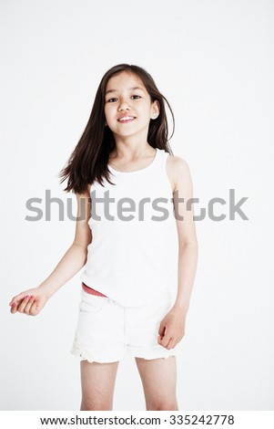 Studio portrait of a girl. Light background - stock photo