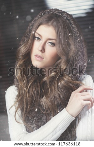 Studio portrait of a girl with snow - stock photo