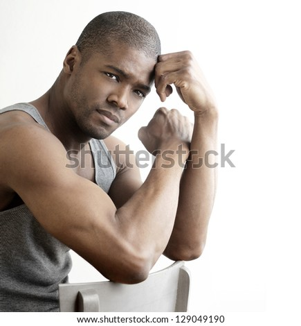 Studio portrait of a good looking young black man against white background with copy space - stock photo