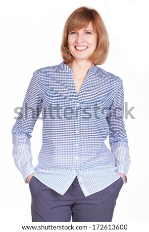 Studio portrait of a gorgeous mature woman smiling at the camera. Isolated on white background. - stock photo