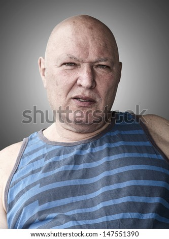 studio Portrait of a hair less real man - stock photo