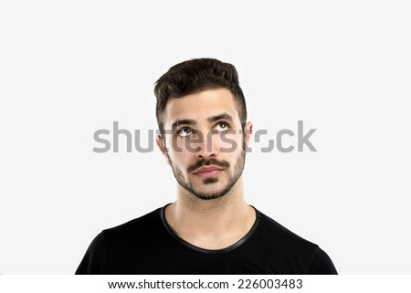 Studio portrait of a handsome young man with a thinking expression