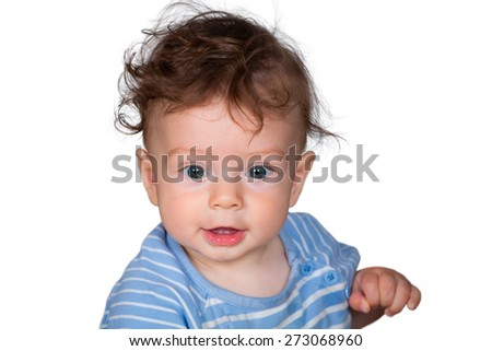 Studio portrait of a happy 7 months old baby boy with blue top.