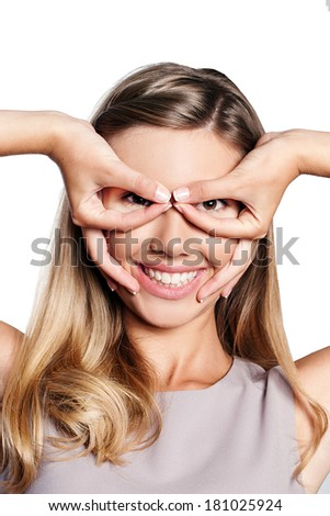Studio portrait of a joyful young woman showing aviator glasses, isolated on white background - stock photo