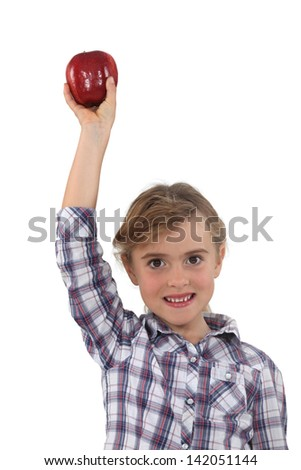 Studio portrait of a little girl with an apple - stock photo