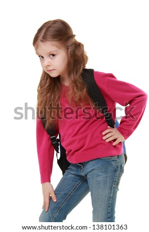 Studio portrait of a little schoolgirl with a backpack