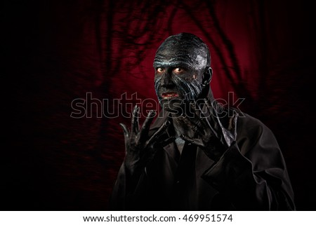 Studio portrait of a man in monster makeup