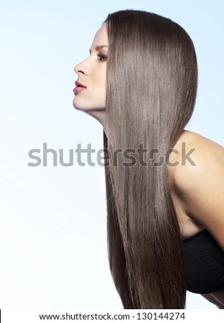 Studio portrait of a model showing her healthy shining hair