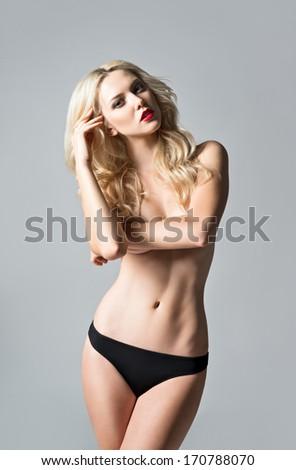 Studio portrait of a sexy beautiful girl in panties - stock photo