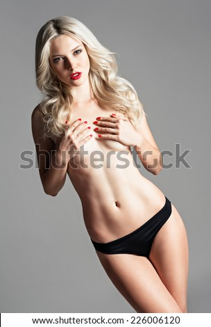 Studio portrait of a sexy beautiful young woman - stock photo