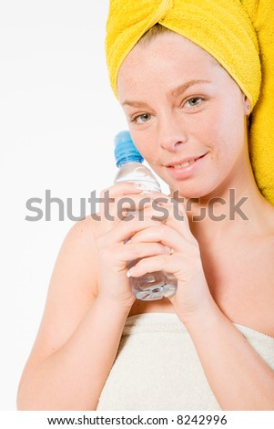 Studio portrait of a spa girl holding a water bottle