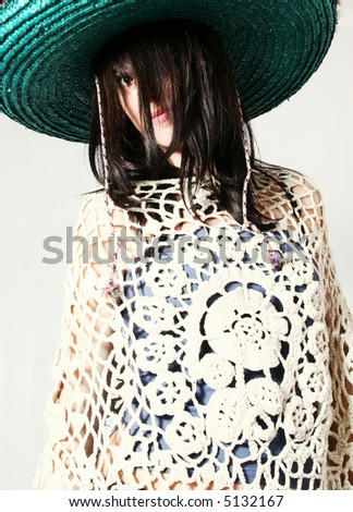 Studio portrait of a woman from mexico with mexican hat - stock photo