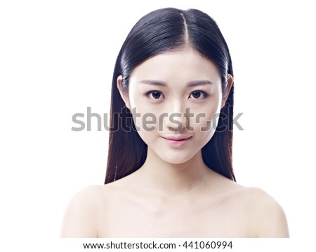 studio portrait of a young asian woman, frontal view, looking at camera, isolated on white. - stock photo