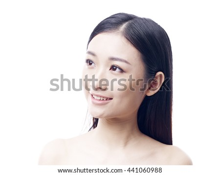 studio portrait of a young asian woman, looking up, side view, isolated on white. - stock photo
