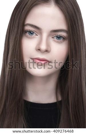Studio portrait of a young brunette - stock photo