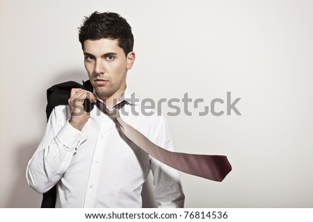 Studio portrait of a young businessman with a flying tie - stock photo