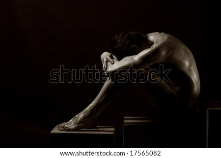 Studio portrait of a young muscular naked man - stock photo