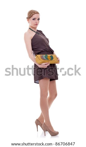 Studio portrait of a young woman with a purse isolated on white background