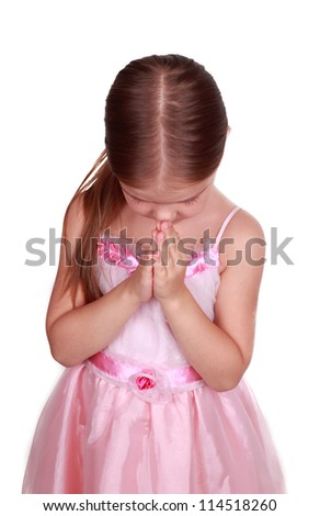 Studio portrait of an adorable praying girl over white background - stock photo