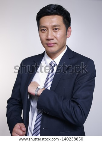 studio portrait of an asian businessman. - stock photo