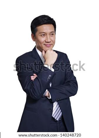 studio portrait of an asian businessman. - stock photo