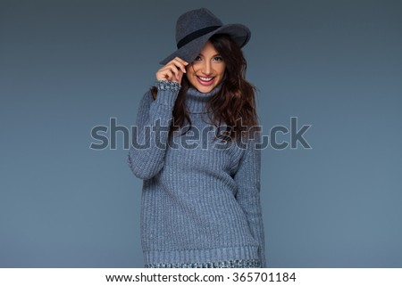 Studio portrait of an emotional woman over neutral grey background - stock photo