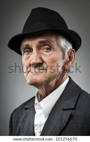 Studio portrait of an expressive old man - stock photo