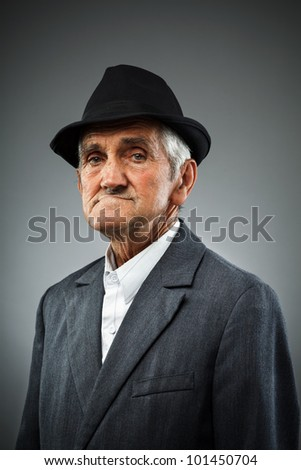 Studio portrait of an expressive old man - stock photo