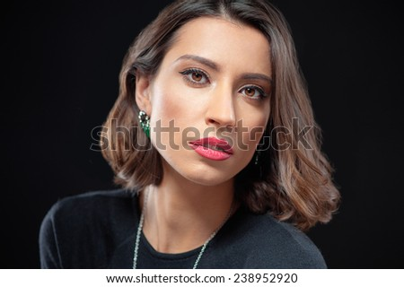 Studio portrait of Attractive confident caucasian woman looking at camera close up  - stock photo