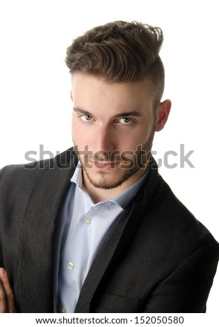 Studio portrait of attractive young businessman looking in camera, on white background - stock photo