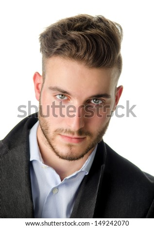 Studio portrait of attractive young man looking in camera, on white background - stock photo