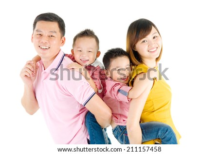 Studio portrait of beautiful asian family - stock photo