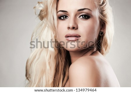 Studio portrait of beautiful blond woman