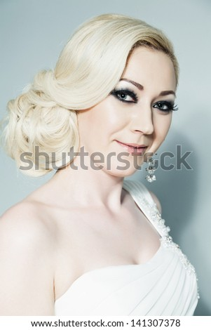 Studio portrait of beautiful blonde bride with selective focus