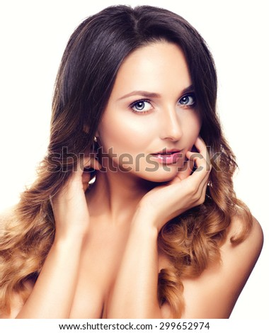 Studio Portrait of Beautiful Model with Long Curly Ombre Hair. Close Up