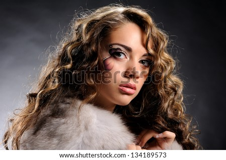 Studio portrait of beautiful sexy girl  in fashion style