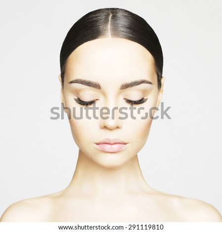 Studio portrait of beautiful young woman with perfect skin. Beauty and care. Extension eyelashes. Spa salon - stock photo