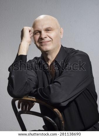 Studio portrait of caucasian bald men. Emotions. Damming smile - stock photo