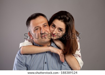 Studio portrait of father and daughter smiling and being happy