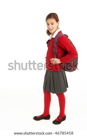 Studio Portrait Of Female Student In Uniform With Backpack