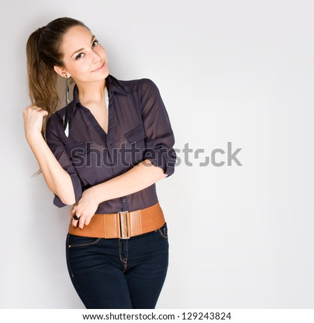 Studio portrait of gorgeous pensive young brunette woman. - stock photo