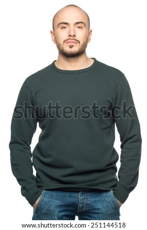 Studio portrait of handsome young pensive man looking in camera, isolated on white