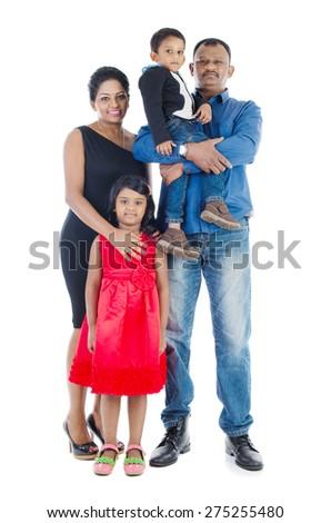 Studio portrait of indian family - stock photo