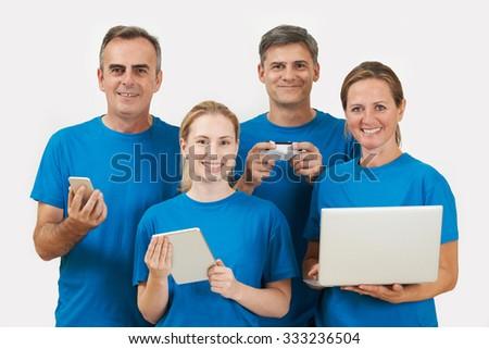 Studio Portrait Of IT Support Staff Wearing Uniform Against White Background - stock photo