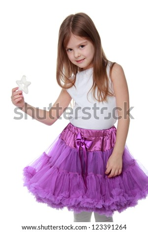 Studio portrait of little girl with little white star on Holiday theme isolated on white background