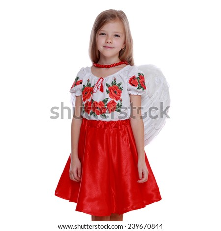Studio portrait of lovely little ukrainian angelic girl with white wings on Holiday theme/Cheerful little girl in a bright Ukrainian national costume - stock photo