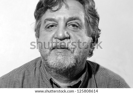 Studio portrait of middle aged man - stock photo