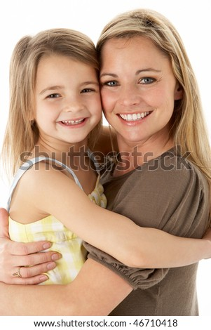 Studio Portrait Of Mother Hugging Young Daughter - stock photo